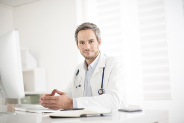 young doctor at his office