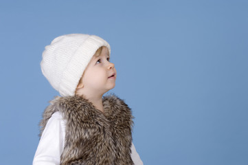 portrait of a toddler with knitted white