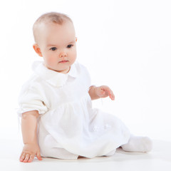 little baby girl sitting on the floor