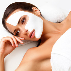 Fototapete - Young Woman at Spa Salon With Cosmetic Mask on Face.