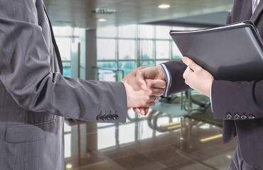Business handshake for a closing deal