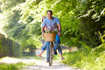 Couple On Cycle Ride In Countryside
