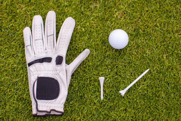 Golf equipment on green grass