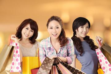 Happy smiling Asian shopping women