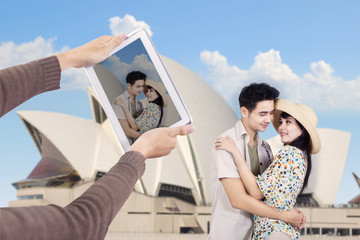 Asian couple take picture at Sydney Opera House