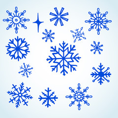 Set blue snowflakes doodle