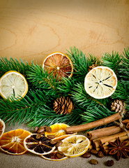 Christmas composition with fir branch and spice