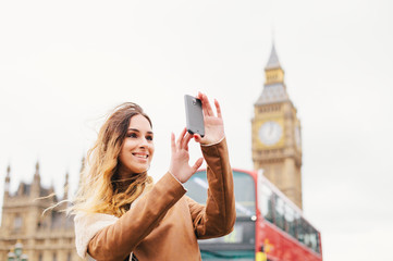 Female turist taking pictures in London