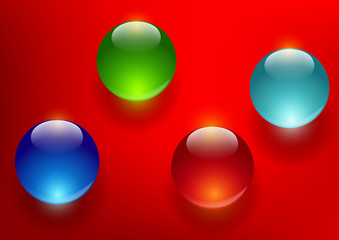 colorful glass balls on a red background