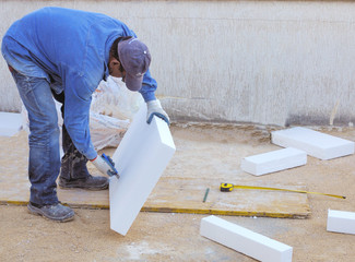 Worker size to fit a polystyrene panel with a cutter
