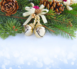 Branches of fir and decorations baubles over festive background