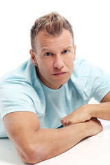Adult man with a shirt posing in studio