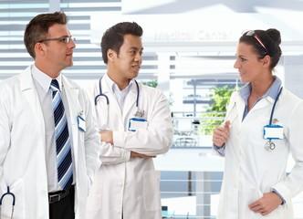 Doctors talking in clinics hallway