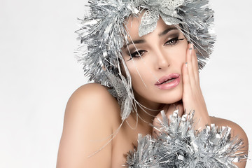 Beauty Christmas Girl with Silver Hair. Winter Woman Makeup and