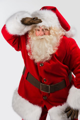 Santa Claus standing isolated on white background and looking fa