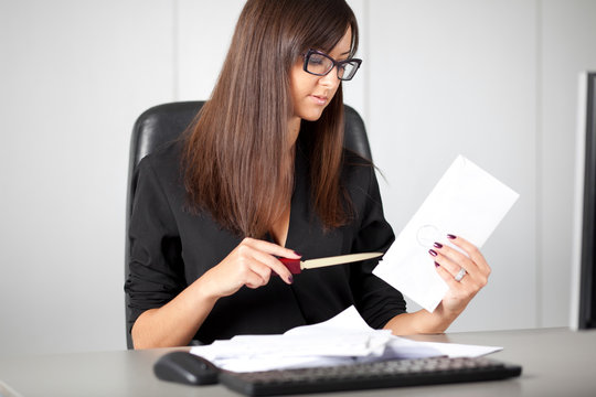 Portrait of a beautiful executive woman secretary at work while