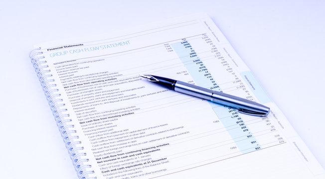 cash flow statement with pen