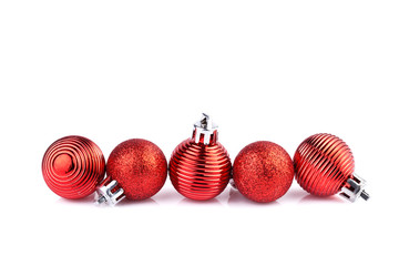 red christmas balls horizontally on straight line