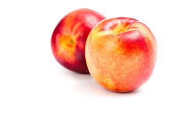 Close up of two peaches, isolated on white