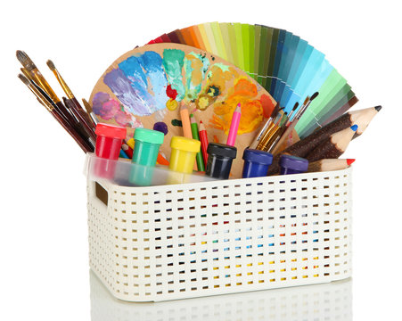 Plastic basket with art supplies isolated on white