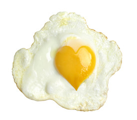 Fried egg with heart form yolk, isolated on white background