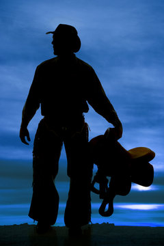 silhouette man holding saddle look side