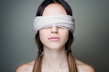 Naked blindfold woman
