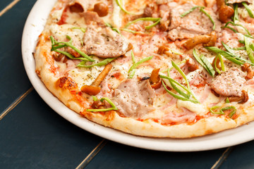 pizza with beef and mushrooms