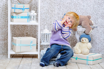 Funny kid and gift boxes