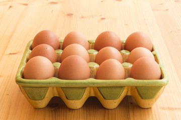 Beautiful kitchen holder full of fresh brown eggs