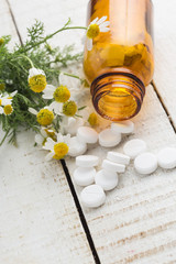 Concept homeopathy. Bottles with medicines and natural herbs.