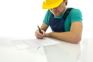 Construction worker signing contract