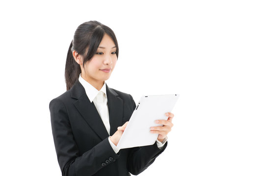 asian businesswoman using tablet on white background