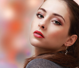 Sexy makeup woman with red lips on colorful background