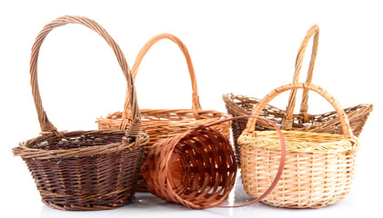 Empty wicker baskets, isolated on white