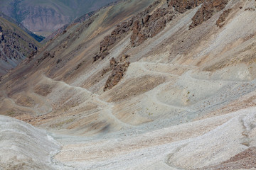 Fototapete - Dangerous serpentine road in Tien Shan mountains