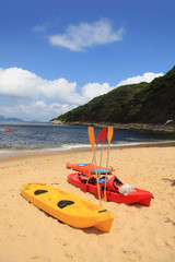 Colorful kayaks and sailing boats for rent