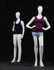 full-length two mannequin dressed in white t-shirt and trousers