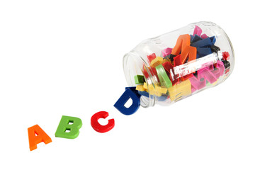 Colorful symbols of alphabet in glass can. Education concept. Is