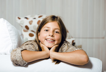 little cute girl at home smiling