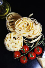 Traditional Italian food tagliatelle with ingredients