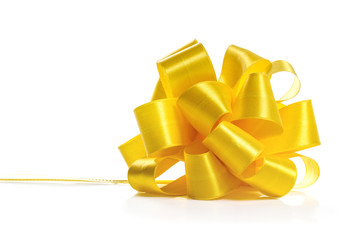 Festive yellow bow on white background