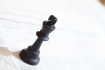 Chess piece on the document
