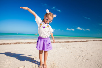 Adorable little girl in easter costume on the exotic beach