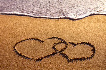valentines day card, two hearts on the beach