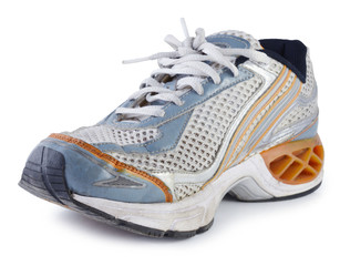 Dirty old gym shoes with white background.