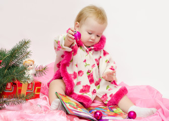 baby with Christmas toys