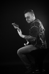 Portrait of guitarist playing