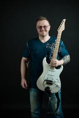 Smiling man holding guitar