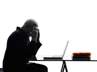 senior business man computing tired headache silhouette